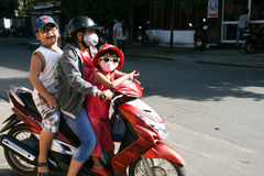 The family on the motorbike in hoi an ancient town,vietnam Stock Photos