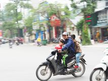 Family on a motorbike - Panning effect Royalty Free Stock Photos