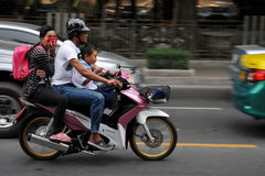 Family on a Motorcycle in Central Bangkok Royalty Free Stock Photography
