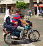 Family motorcycle Tehran road Iran. TEHRAN, IRAN - MAY 19, 2017: Family on a motorcycle on Tehran road. Tehran is the capital of Iran stock images