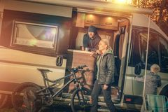 Family Motorhome Camping. Young Modern Caucasian Family with RV Motorhome Camper Van on the Campsite stock photos