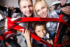 Family with mountain bike Stock Image