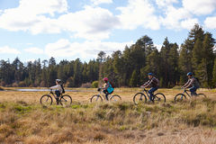 Family mountain biking in countryside, Big Bear, California stock photography