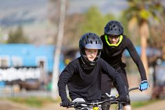 Family mountain biking royalty free stock photography