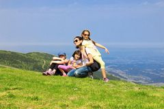 Family on the mountain Stock Images