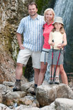 Family on mountain trek Royalty Free Stock Photo