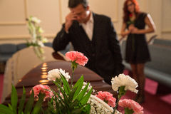 Family mourning. Their loss at the service Royalty Free Stock Images