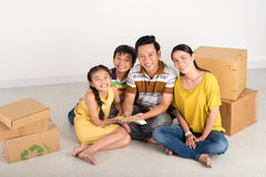 Family with moving boxes and color samples Royalty Free Stock Photos