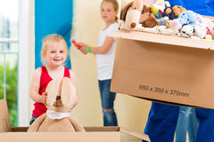 Family moving home and renovating house Royalty Free Stock Image