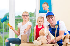 Family moving home and renovating house Stock Photos