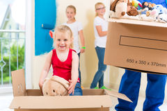 Family moving home and renovating house Royalty Free Stock Photos