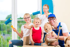 Family moving home and renovating house Royalty Free Stock Images
