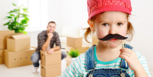Family moving home and renovation. funny girl with a mustache f. Family moving home and renovation. funny child girl with a mustache foreman and father royalty free stock image