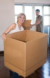 Family moving house. Young couple in love moving house royalty free stock photography