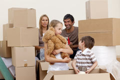 Family moving house playing with boxes Royalty Free Stock Images