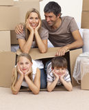 Family moving house playing with boxes Stock Photos