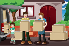 Family moving house. A vector illustration of happy family moving house and taking boxes into a car Stock Photography