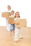Family moving in a new home Royalty Free Stock Images