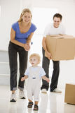 Family moving into new home smiling Royalty Free Stock Images