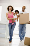 Family moving into new home smiling Stock Photos