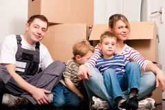 Family moving in their new home Stock Images