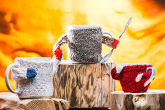 Family of mugs in sweaters Stock Image