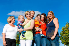 Family and multi-generation. Mother, father, children and grandmother having fun on meadow in summer Royalty Free Stock Photography