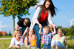 Family and multi-generation - fun on meadow in sum. Family and multi-generation - mother, father, children and grandmother having fun on meadow in summer Stock Photography