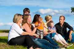Family and multi-generation - fun on meadow in summer. Family and multi-generation - mother, father, children and grandmother having fun on meadow in summer Royalty Free Stock Photos