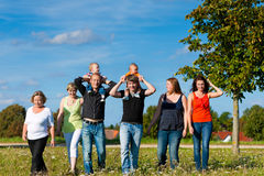 Family and multi-generation - fun on meadow in summer. Family and multi-generation - mother, father, children and grandmother having fun on meadow in summer Stock Photo