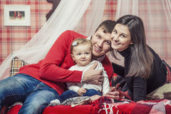 Family mum dad and kid together at home of the bedrooms in winte Royalty Free Stock Photography