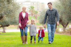 Family mum dad and kids. Walking outdoors in park Stock Photos