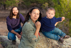 Family in nature. Young multicultural family in nature - shallow DOF - focus on mother & baby Royalty Free Stock Photo