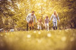 Family in nature. Family spending time together at park royalty free stock image