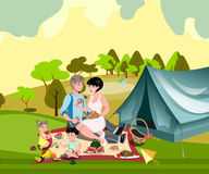 Family in nature with a tent Stock Photos