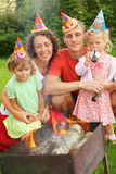 Family near brazier on picnic, happy birthday. Happy family with children near brazier on picnic, happy birthday party seven years royalty free stock photography