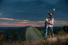 Family near camp tent on the hill stock photography