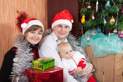 Family near Christmas tree Royalty Free Stock Image