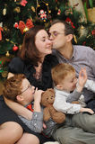 Family near the Christmas-tree Stock Image