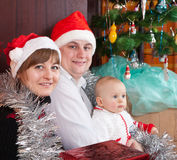 Family near Christmas tree Stock Image