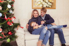Family near Christmas Tree Royalty Free Stock Images