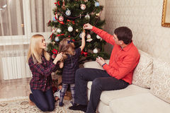 Family near Christmas Tree Stock Photo