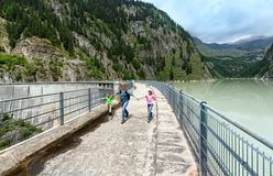 Family near dam ( Switzerland) Royalty Free Stock Photos