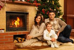 Family near fireplace in Christmas house Stock Photography