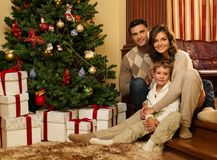 Family near fireplace in Christmas house Royalty Free Stock Photo