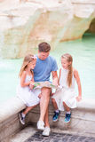 Family near Fontana di Trevi, Rome, Italy. Happy father and kids enjoy italian vacation holiday in Europe. Happy family near Fontana di Trevi with city map Royalty Free Stock Image
