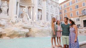 Family near Fontana di Trevi, Rome, Italy. Happy parents and kids enjoy italian vacation holiday in Europe. stock video