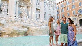 Family near Fontana di Trevi, Rome, Italy. Happy parents and kids enjoy italian vacation holiday in Europe. stock footage