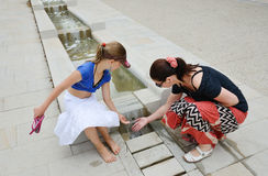 Family near the fountain in the Basque town Stock Photos