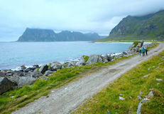 Family near Haukland beach (Norway, Lofoten). Royalty Free Stock Images